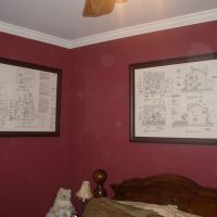 guestroom-with-framed-drawings
